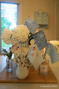 A Pocketful of Blue - little flags made from fabric scraps and sticks from the yard. How cute and easy!