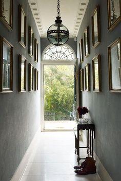 Charcoal Gallery Wall & Period Light - Hallway Design Ideas (houseandgarden.co.uk)