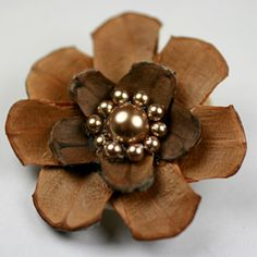 Pinecone Flower.... Maybe with a button in the center instead????