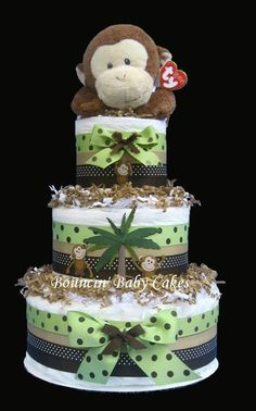I used to love making diaper cakes.  This one is really cute!  Green and Brown Mod Pod Pop Monkey Diaper Cake. $89 via Etsy.
