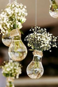 budget rustic wedding decorations flowers gypsophila in vases similar to light bulbs suspended on a rope colin cowie weddings #BrilliantInteriorPlanning #weddingflowers #weddingdecoration #rusticweddingflowers