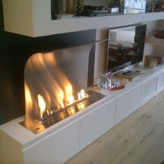 It's important to be safe while enjoying the well-lit fire in your fireplace when temperature drops down. Here is a wide range of modern ethanol fireplaces to choose from. Ethanol Fireplace, Fireplace Wall, Fire Pit Bbq, Modern Family Rooms, Muebles Living, Traditional Fireplace, Home Tv, Apartment Design, Home Renovation