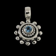 Sterling silver pendant with blue topaz