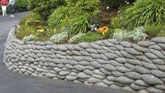 Concrete 'bag' retaining wall.