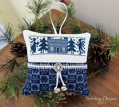 Blue-themed cross-stitch Christmas ornament (source: http://stitchingdream.blogspot.com/2011/12/2011-christmas-ornaments-and-crazy-for.html)