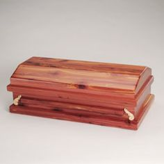 """Selecting the caskets had furnished the most torture. You shouldn't be able to pick up a coffin for a person with your own two hands. You needed to call on eight strong men, or at least six. Palmer wasn't sure he and Carolyn would make it through the task, but what had held them up had been the funeral director, Matt MacKay, and his gentle comfort and sympathy, devoid of pity. --from """"Handfuls"""""""