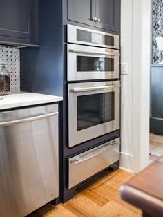An oven, warming drawer and microwave stacked one atop another provide convenience and enough cooking space to accommodate food for large parties and holiday gatherings. Stainless Appliances Kitchen, Kitchen Inspirations, Home, Kitchen Decor, New Kitchen, Warming Drawer, Home Kitchens, Kitchen Tech, Kitchen Pictures