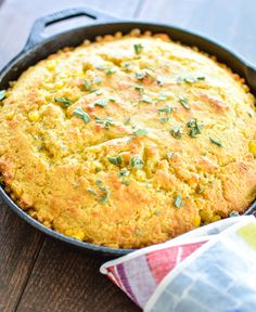 The perfect addition to your Thanksgiving spread: Cheesy Brown Butter Skillet Cornbread | www.cookingandbeer.com | @jalanesulia