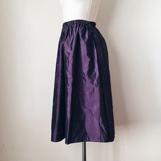 """UO   Purple Midi Skirt Show love for our planet by slipping into this purple midi skirt by Urban Renewal, made of 100% recycled, vintage fabrics.   FEATURES:  * Elastic waistband  * Modern, minimal styling  * Made of synthetic, recycled vintage fabrics  MEASUREMENTS: Waist - 24 1/2"""" (stretches to 28)  Hips - 44"""" Length - 29""""  ✅ NWT ⛔️ NO SWAPS/TRADES/RESERVES Urban Outfitters Skirts Midi"""
