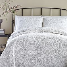 Infuse your bedroom with the warmth and textured beauty of the Jessica Simpson Medallion Coverlet. Showcasing an allover quilted medallion design on a crisp white ground, this layering piece will adorn your bed with a touch of classic elegance.