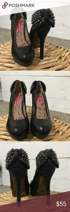 Betsey Johnson Pumps Betsey Johnson black platform leather pumps with bowtie and metallic detail on back. Does have small scuff on one of the shoes that could be colored in with black marker. Size 7. 1 inch platform with 5 inch heel. Super cute and fun! Betsey Johnson Shoes Platforms