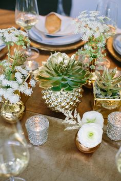small gold vases and votives, photo by CarolineRo http://ruffledblog.com/charity-inspired-wedding-ideas #gold #centerpieces #reception