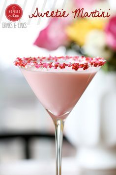Sweetie Martini |  2 ounces vanilla vodka 2 ounces Godiva white chocolate liqueur 1 ounce amaretto liqueur 1/2 ounce grenadine 2 ounces half and half Honey and sprinkles for garnish