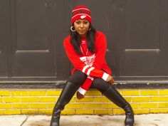 Rock that Red and White!  Teresa is wearing a Red Wings skull cap and Red Wings jersey with black leggings and black knee-high boots.