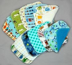 One dozen (12) assorted cloth baby diaper wipes (small washcloths), made from a variety of diaper-making fabrics. The perfect complement to your