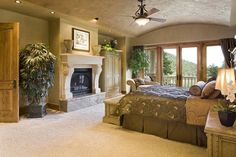 master bedroom with fireplace and balcony