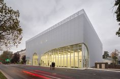 modern white public facade. light elevation AUDITORIUM OF BONDY