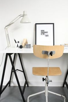simple workspace.   Ikea sell trestles & work tops to make something similar. i like the mix of black, white laminate & the plywood chair, it's informal but functional and easy to transport come moving time.
