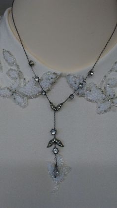 Short silver pewter necklace with cascading teardrop round clear rhinestones