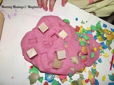 Toddler Sensory  Playdough Fun.  Use Eggshells with play doh.  Cool idea for after Easter.