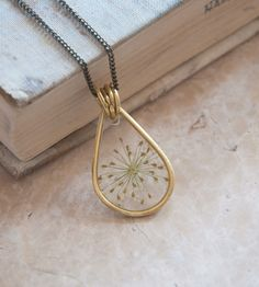 Queen Anne Brass Necklace   An ethereal specimen of Queen Anne's Lace is preserved in resi...   Necklaces