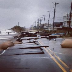 KDH and Kitty Hawk flooding | OBX Connection Message Board/A section of the beach road in Kitty Hawk breaking up as the ocean continues to was over during hurricane Sandy. 10/29/12 2:41 P.M.