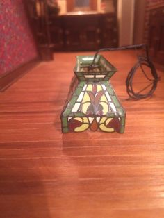Barbara and Lew Kummerow - hanging stained glass light fixture