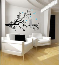 Cat on a tree branch  with 7 Birds  23.5h x 35w    ( shown in Black & Med Grey) (Birds- Geyser Blue)    Please leave message in seller box  Color of branch:  Color of Cat:  Color of Birds:      If you need a different size contact us for a quote    This decal will add elegance to
