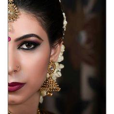 South Indian bride. Gold Indian bridal jewelry.Temple jewelry. Jhumkis. Maang tikka.silk kanchipuram sari with contrast green blouse.Braid with fresh jasmine flowers. Tamil bride. Telugu bride. Kannada bride. Hindu bride. Malayalee bride.Kerala bride.South Indian wedding.