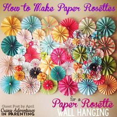 Here's a fun and gorgeous way to dress up any wall - gorgeous paper rosettes! Learn how to make paper rosettes with this tutorial!