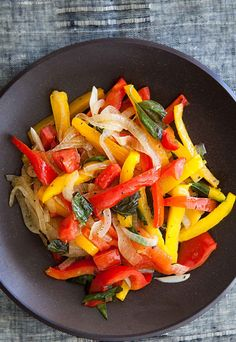 Peperonata! An easy summer side dish with Italian bell pepper, onion, tomato sauté, with garlic, ground oregano, and fresh basil. On SimplyRecipes.com