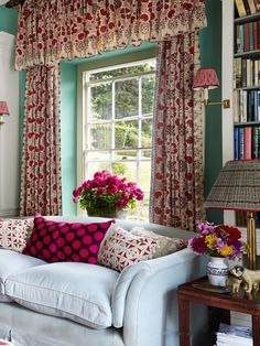 Penny Morrison library - Arabella linen hangs against walls of Farrow and Ball's Arsenic. The lampshades and Pink Spot cushion are from Irving & Morrison
