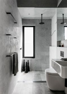 In lieu of traditional bathroom decor (like colorful bath mats or a thriving plant) we're encouraged to take a different approach, such as highlighting the architectural elements of a room. To help you get started we compiled a shortlist of the minimalist shower ideas you need on your radar. #hunkerhome #minimalist #showerideas #minimalistshowerideas #bathroom Minimalist Bathroom, Bathroom Decor, Black Bathroom, Bathrooms Remodel, Black Bathroom Accessories, Black Bathroom Taps, Bathroom Renovations, Black Faucet Bathroom, Bathroom Design