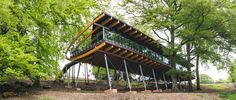 Looking as though it were poised to take flight, the Blackburn Wing is a multi-award-winning conference venue located within the ancient woodlands of the historic Bowcliffe Estate in Yorkshire, UK. Designed by The Harris Partnership and commissioned b