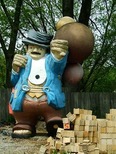 """Giant Hobo"" in Merrillville, Indiana - photo by Cindi G. (Doctor Beef), via Flickr;  He used to stand outside a local hotdog joint called Arman's.  (His balloons used to be brighter.)  He has a 'brother' in Lake Station, IN."
