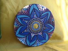 Paint a mesmerizing mandala onto a CD...you could even make a whole bunch of these then hang them from a wooden craft ring for a beautiful chandelier/mobile decor!