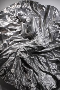 """""""Son Myung Hee"""", made of aluminum wire, from a distance looks like a person frozen in carbonite; by Seung Mo Park, a Korean artist based in the USA."""