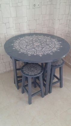 Stencilled table and matching chairs