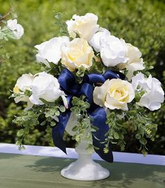 Google Image Result for http://www.afloral.com/Yellow-Blue-Milk-Glass-Short-Centerpiece.jpg