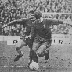 18th January 1969. Chelsea winger Charlie Cooke in a foot race with Liverpool's Emlyn Hughes.