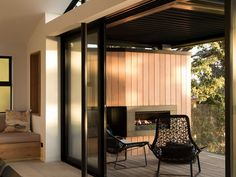 Image 17 of 23 from gallery of Herne Bay Hideaway / Lloyd Hartley Architects. Photograph by David Straight Outdoor Wood Fireplace, Concrete Fireplace, White Fireplace, Outdoor Fireplaces, 1960s House, S Brick, Wood Supply, Long Driveways, House And Home Magazine