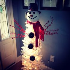 I found 4ft white tree at Kohls, used a styrofoam ball, sprayed with snow paint for his head. I wired a skinny dowel in tree and stuck heard on dowel.  Found life-like carrots at Michaels.
