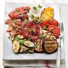 Fire-Seared Antipasto Platter   This classic Italian appetizer makes a great fridge-clearer: Throw whatever vegetables you've got on the grill, and pair with cheese, cured meats, condiments like capers and olives, and anything else you want to include.   CookingLight