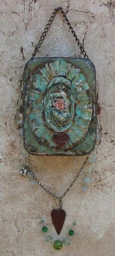 Altered art from Altoid tin