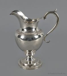 "American coin silver creamer, 19th c., bearing the touch of Edward Kinsey (Newport, Kentucky and Cincinnati, Ohio), 7 1/2"" h., 11 ozt. Provenance: Descended in the Hood family of Louisville."