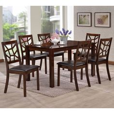 Enrich your home with the contemporary style of this dining set. This table and chair set is finished in a rich dark brown hue with black faux leather upholstery for a comfortable, elegant look.