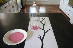 Kersenbloesem schilderij van een gerecyclede fles