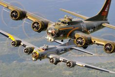 """Thunderbird"" and ""Liberty Belle"": A pair of historic B-17 Flying Fortresses in flight."