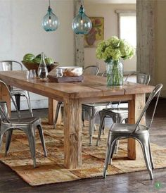 Reclaimed wood table from floor boards. Love the texture between the table and metal chairs.