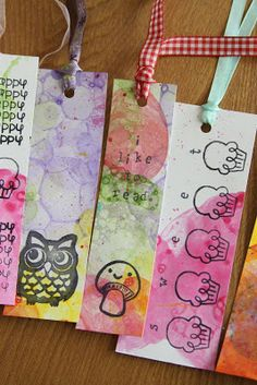 Here is the project the girls & I made today with our bubble paintings .  Origami bookmarks!   I have made some simple folded triangle bookm...